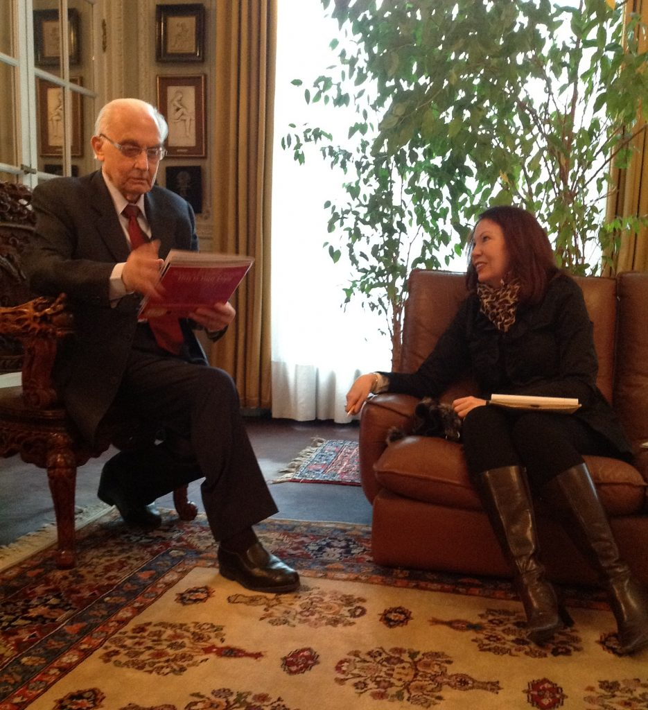 Angela O'Mara interviewing world-renowned plastic surgeon Dr. Pierre Fournier at his home in Paris, France.
