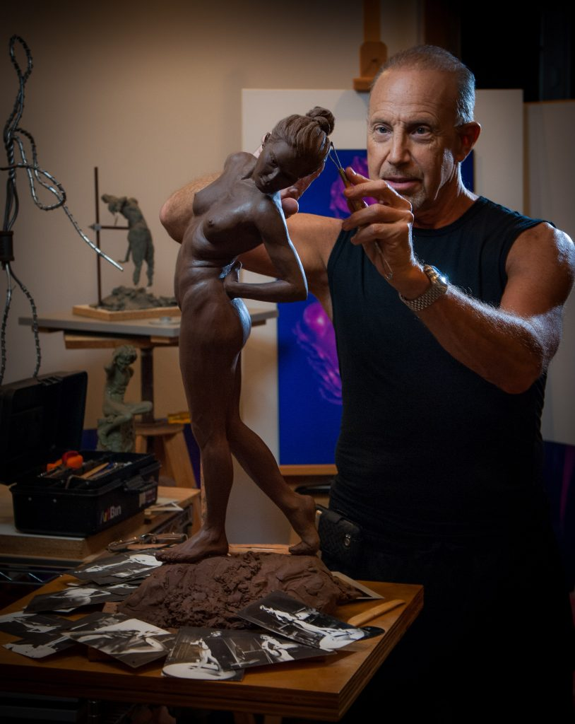 Dr. Laurence Rifkin sculpting another masterpiece at his studio in California.