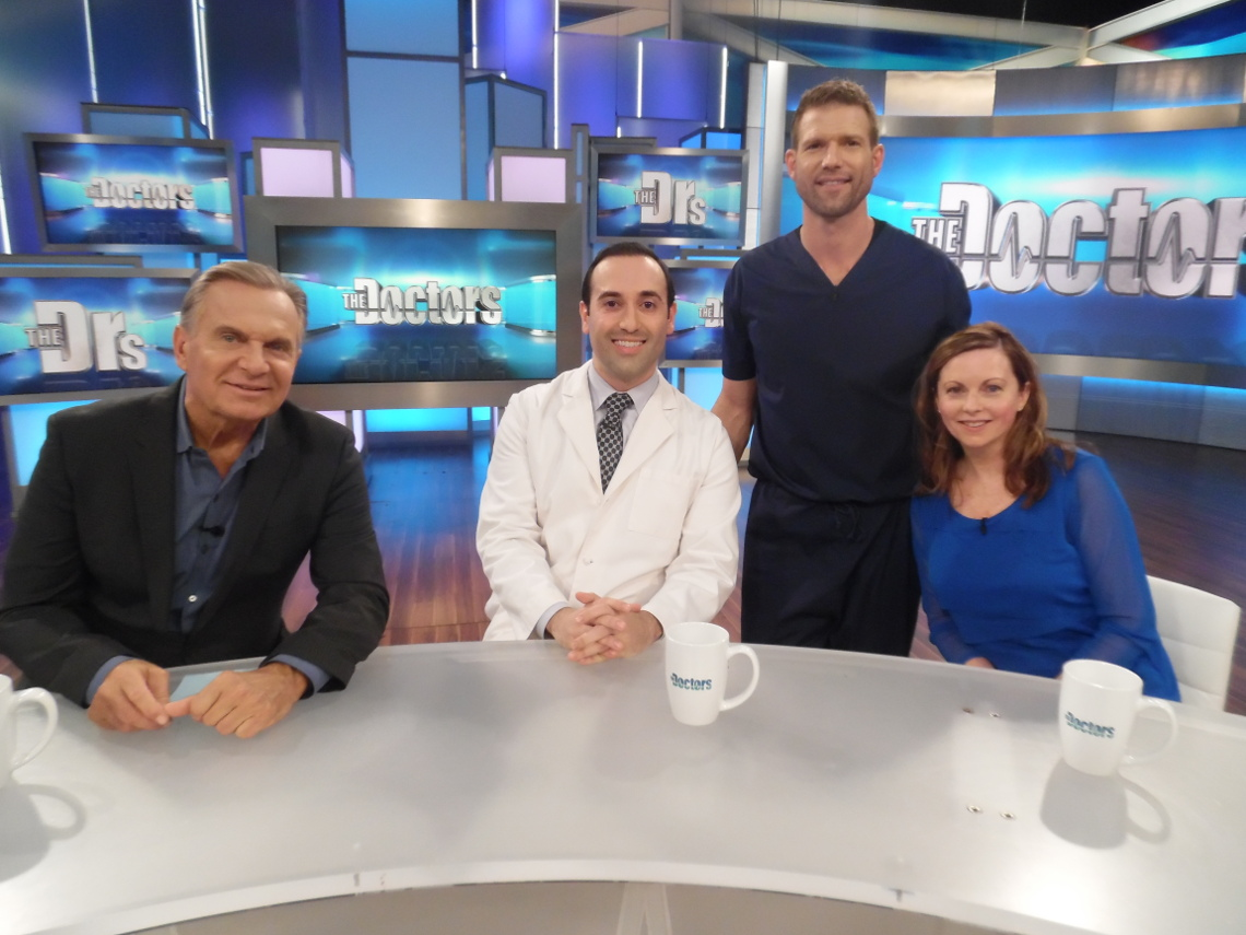 Dr. Kian Karimi and patient with Dr. Andrew Orden and Dr. Travis Stork of CBS The Doctors TV Show.